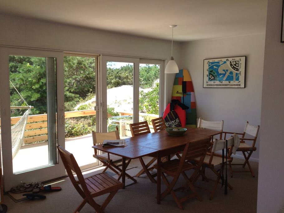 family area with sliding glass door to deck