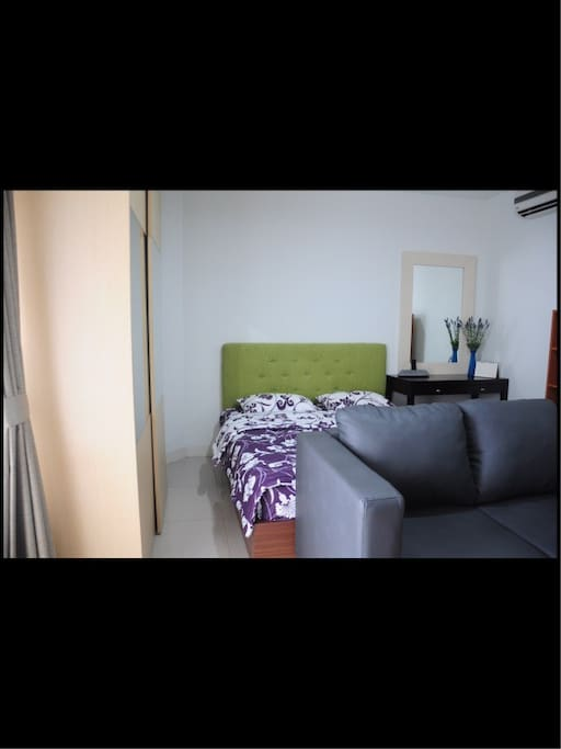 Compact yet convenient sleeping area with many space for storage (wardrobe, below bed storage)
