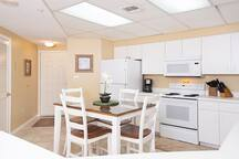 A full suite of appliances, including a refrigerator with icemaker, a stove/oven combo, and a dishwasher.