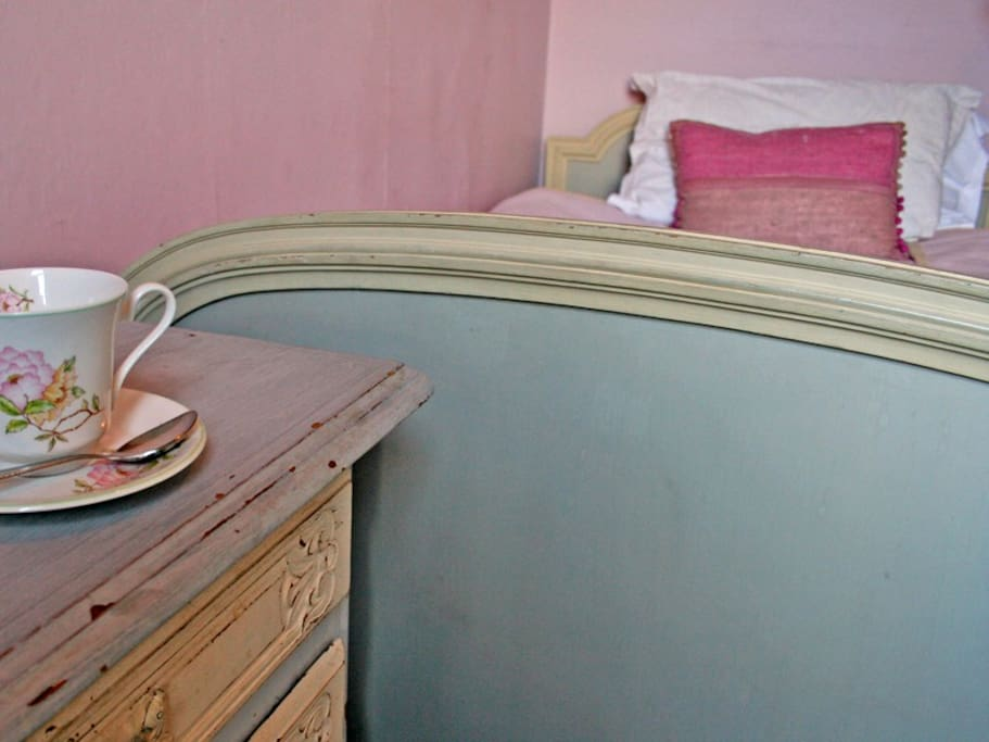 """Belle Isle is a single room decorated with calm Laura Ashley colours and French country antique furniture. A larger than normal 3'6"""" wide bed is topped with a thick bespoke mattress for an excellent night's sleep. There is a small shower en-suite."""