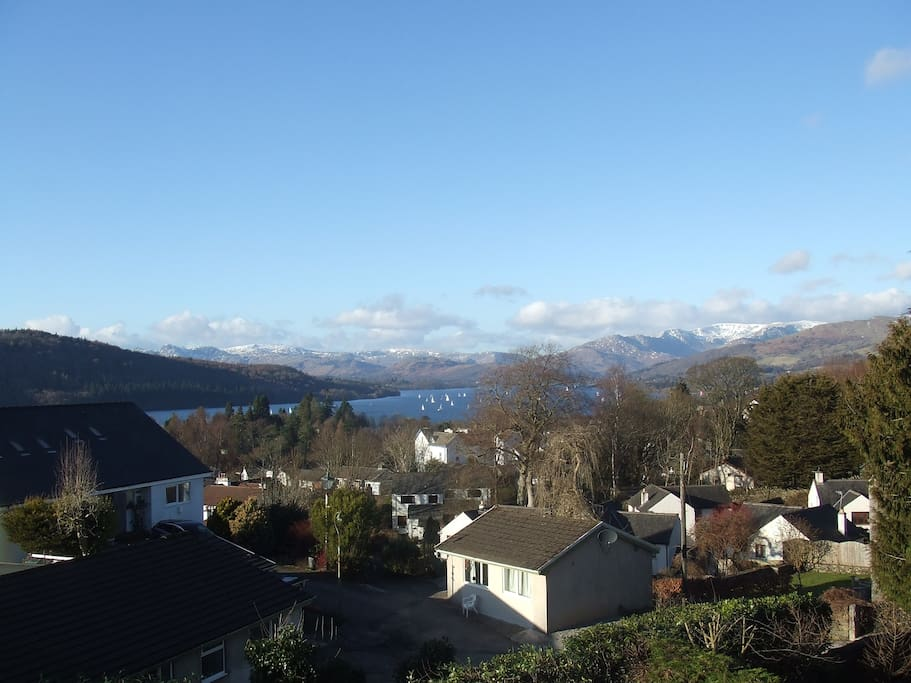 A view over Old Bowness, Lake Windermere and its surrounding mountains may be seen from the single bay window in Belle Isle, one of 3 single bedrooms we have at Blenheim Lodge.