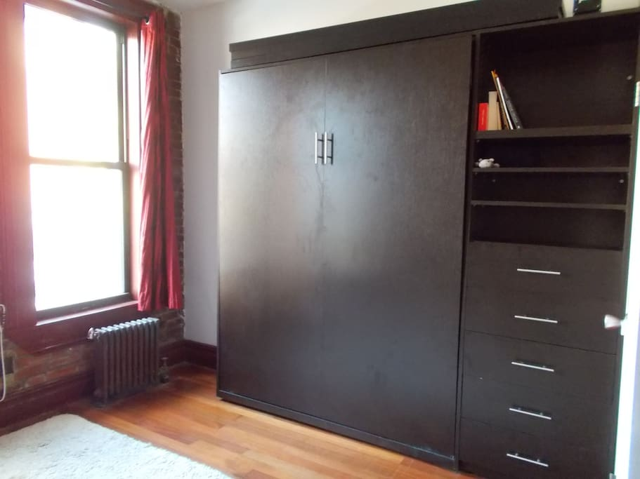 Queen size murphy bed folds up to create more space