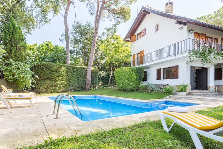 Cute house with wooden shutters large enclosed garden near Lloret de Mar