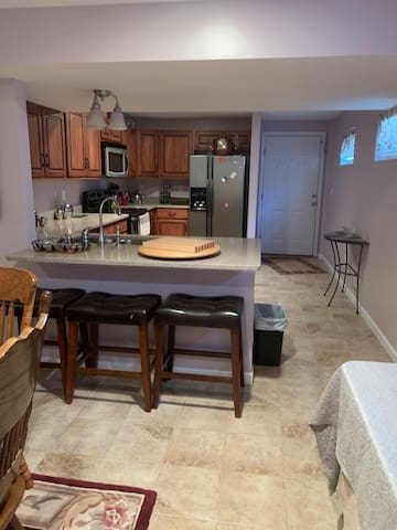 Full kitchen, granite countertops, sink, refrigerator and stove. Bar stools or dining room table to enjoy your home cooked meals or order in from local restaurants.