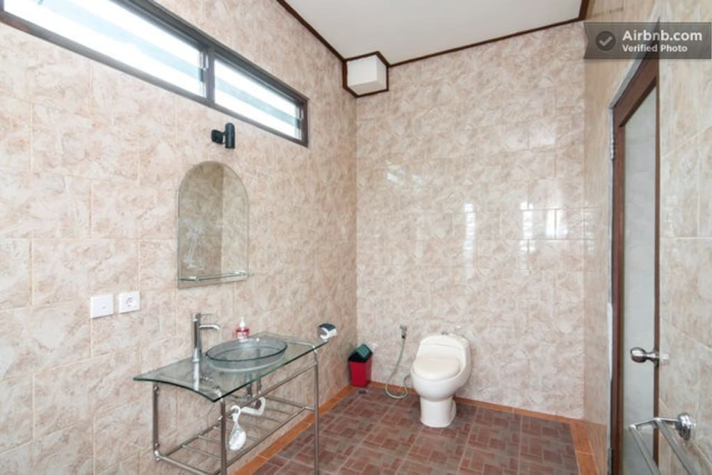 Large bathroom with shower. Clean and simple.
