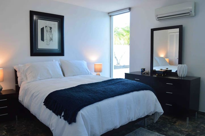 Guest room three with queen bed and private pool access.