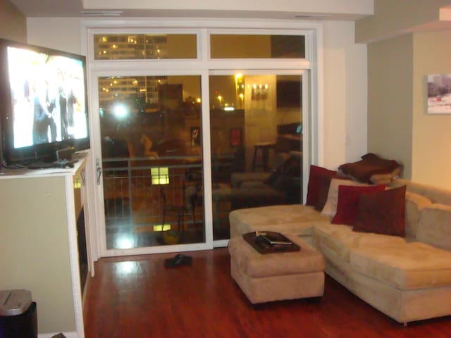 The living room opens to the balcony, and shares the dining room, both of which open into an open kitchen.