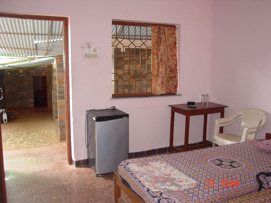 Non-A/c room with Tv, Fridge and Attached Bath with Hot Shower.