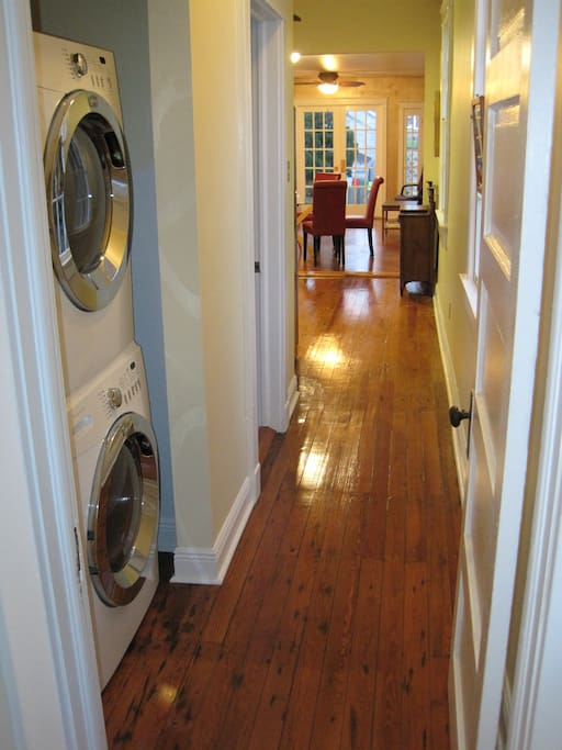 Hallway with new washing machine and dryer