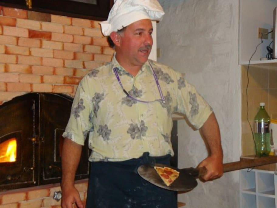 inside the kitchen we cook at wooden oven besides the use of other new appliences