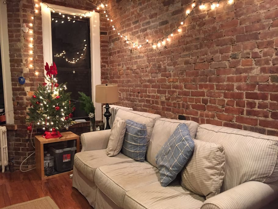 Cozy living room with exposed brick