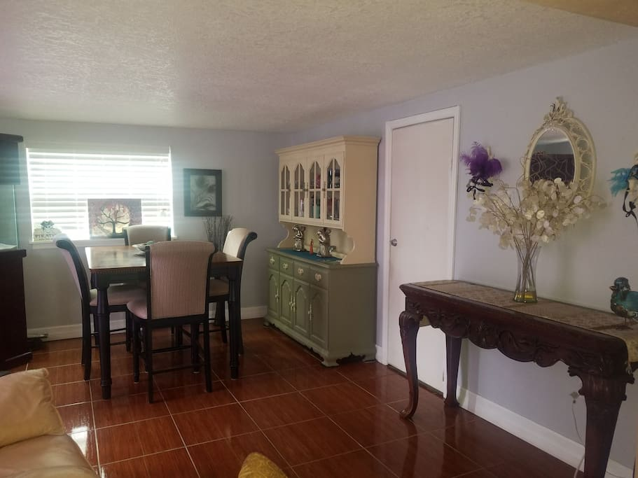 Diningroom with counter height tables and China hutch
