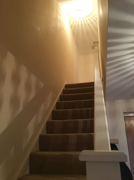 Stairs leading to bedrooms and bathrooms