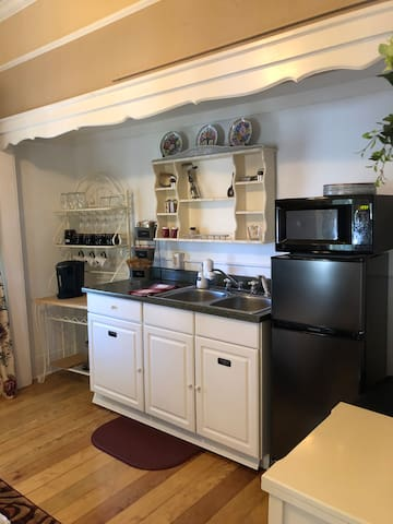 Kitchenette with microwave, refrigerator,  K-cup coffee maker, hot water carafe for beverages or hot cereal.