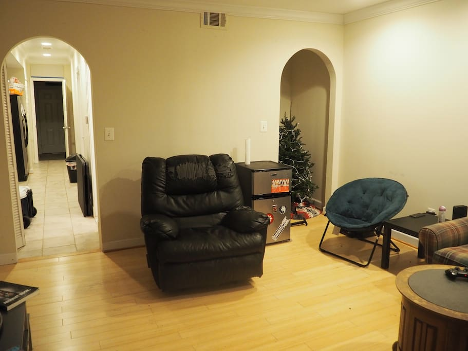 Here's another view of the living room, where you can see the reclining chair and mini-fridge.