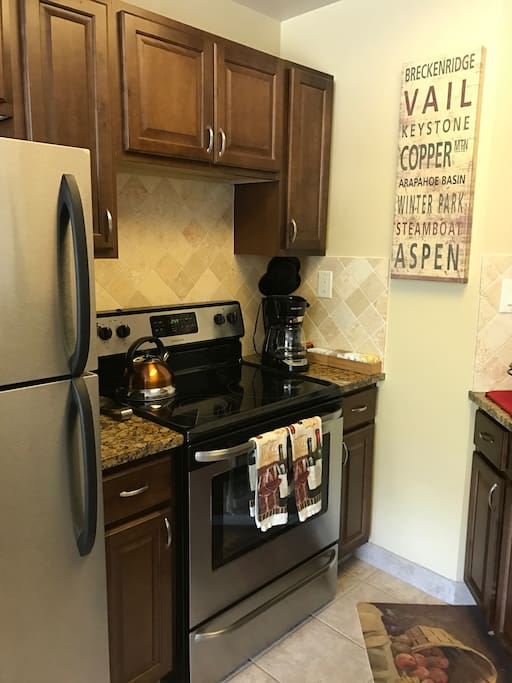 Well equipped kitchen with stainless appliances