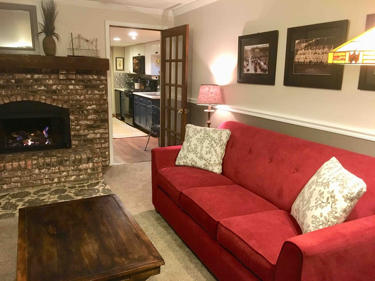 Living room with sofa bed and gas log fireplace.