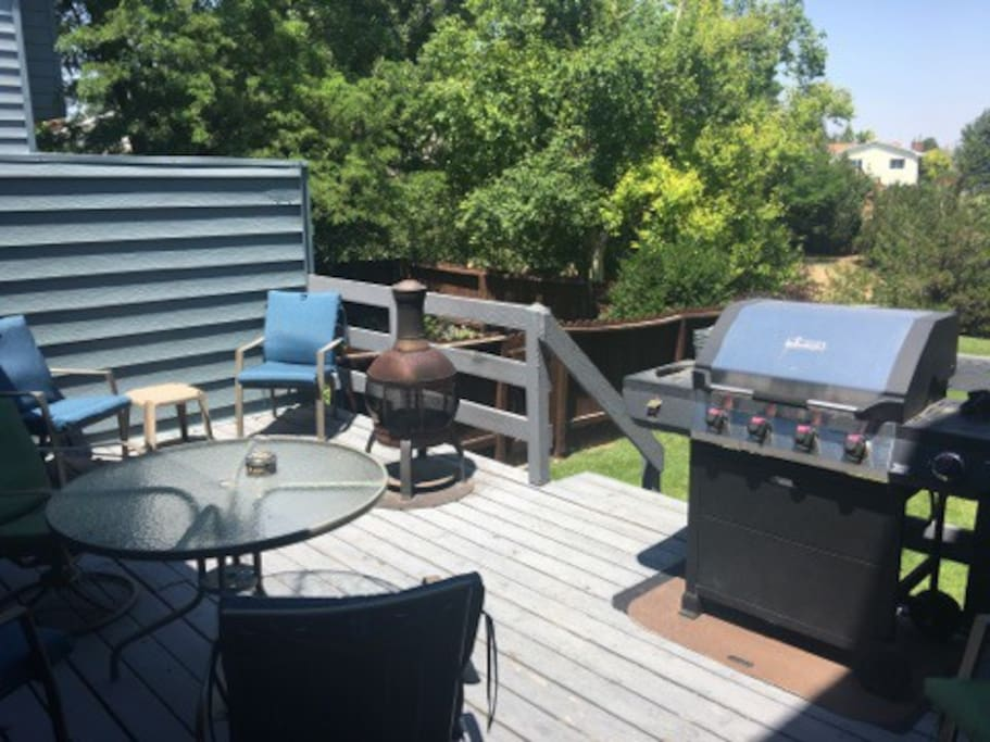 Peaceful patio with convenient grilling amenities.