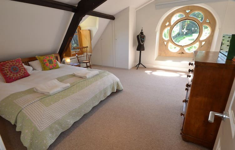 Master bedroom with Super King size bed and rose window