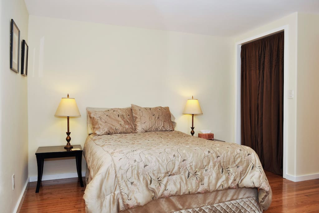 Comfortable double bed with morning light.
