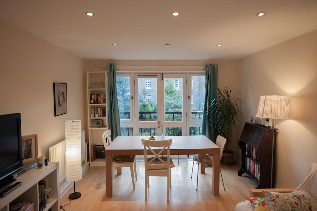 Spacious living room with sofa/sofa bed, TV and DVD player, overlooking quiet garden.