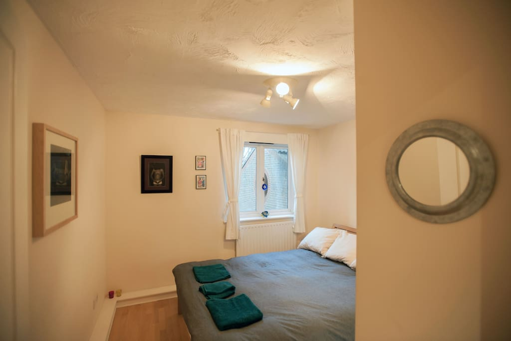 Cosy and quiet bedroom with king-size bed and fitted wardrobes.
