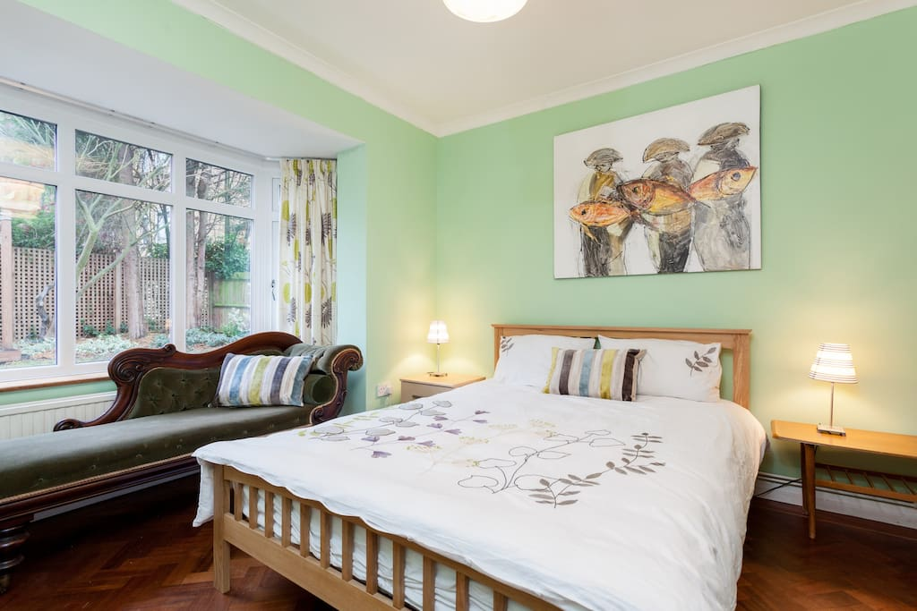 Garden bedroom,  Queen sized bed, cable TV and view over the garden.