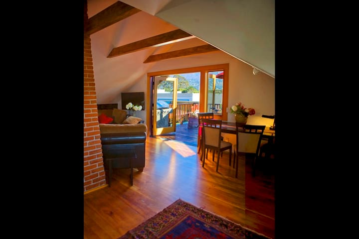 Greatroom with beamed ceilings open between livingroom, dining room and kitchen