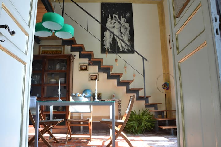 dining room and stairs to the mezzanine