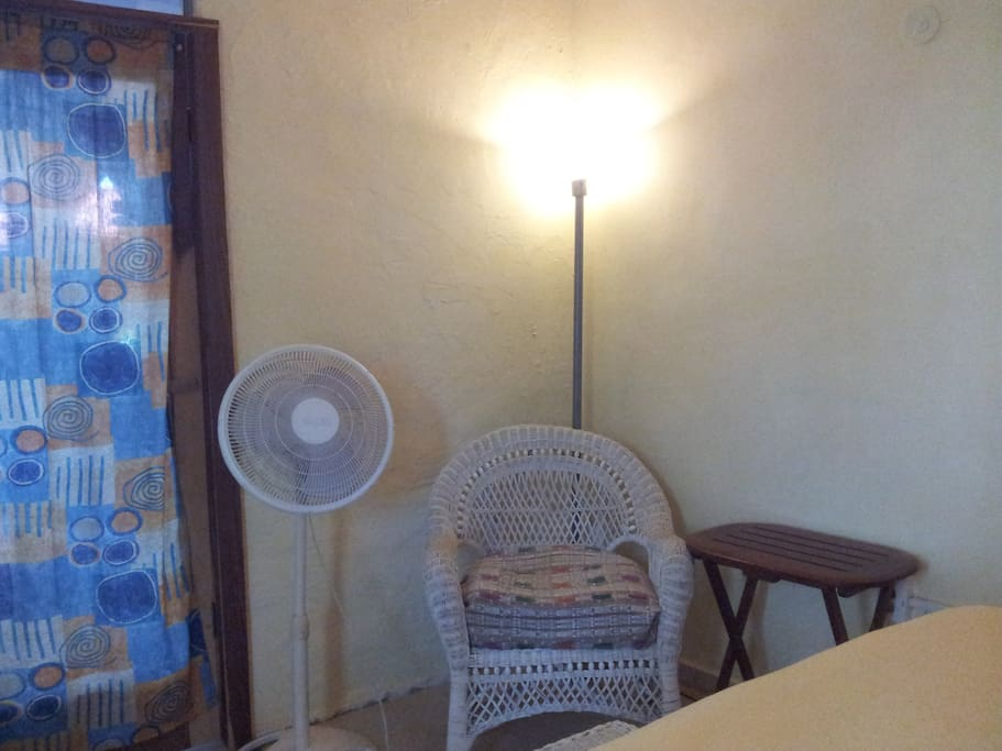 There's a fan,  an armchair and  a reading light.
