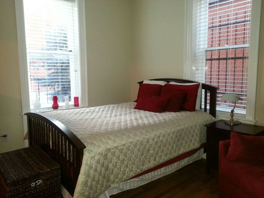 Bedroom with queen bed and pull out twin size sleeper chair