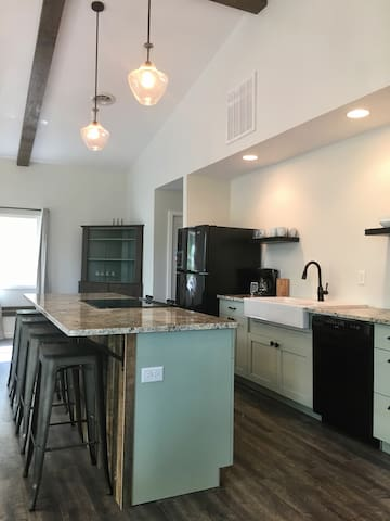Large open kitchen with farm sink, stove, oven, dishwasher and all the cooking supplies you might need!