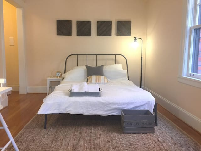 Queen size bed with great natural lighting