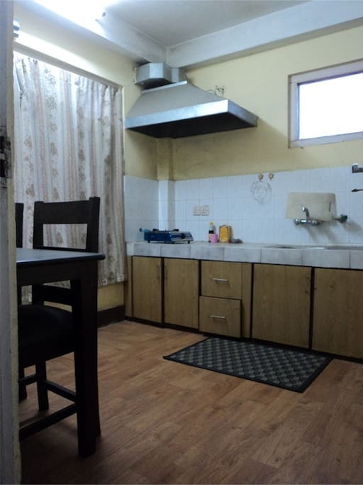Private kitchenette adjoining the living room. Kitchen has got basic accessories, refrigerator, tea maker.