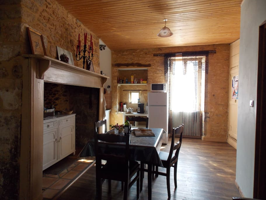 The centre of the flat is the charming kitchen with lovely stone features, giving access to all rooms.