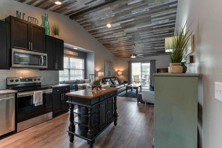 Our condo boasts an open concept living / dining / kitchen area with a 12 foot vaulted ceiling. The open concept gives a very spacious feel and is wonderful for entertaining and spending time with family!