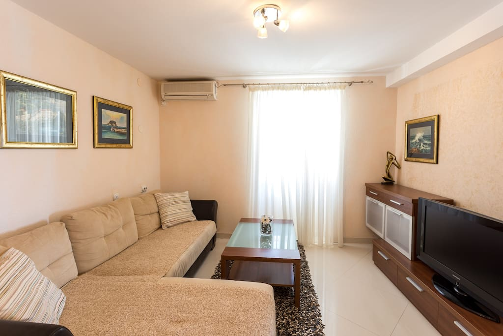 Living room with sofa bed, flat TV with cable channels, air conditioned and very comfortable