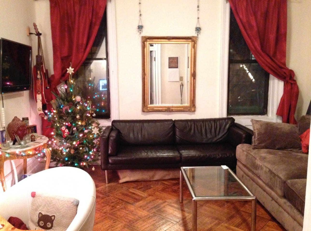 This is the living room. We are on the ground floor, so our windows look out onto our brownstone and tree-lined block.