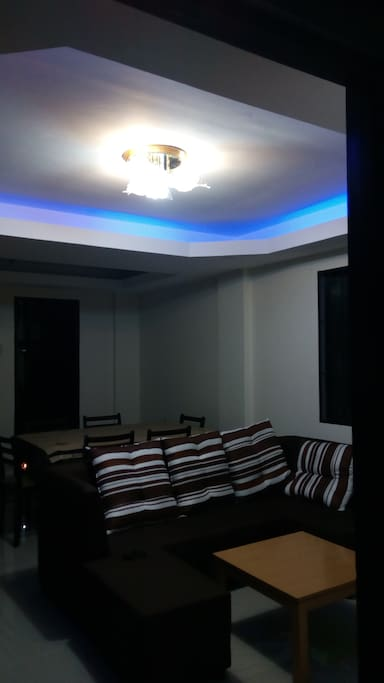 Living room with dim light and chandelier