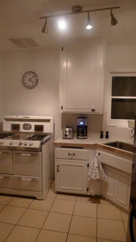 Refurbished 1940 cottage kitchen with original O'Keefe and Merrit stove.
