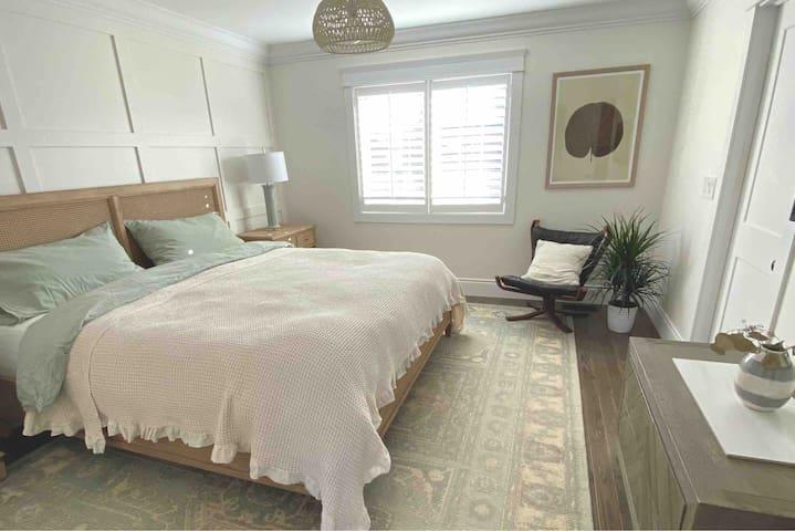 Master bedroom with smart tv, king size bed and en-suite bathroom