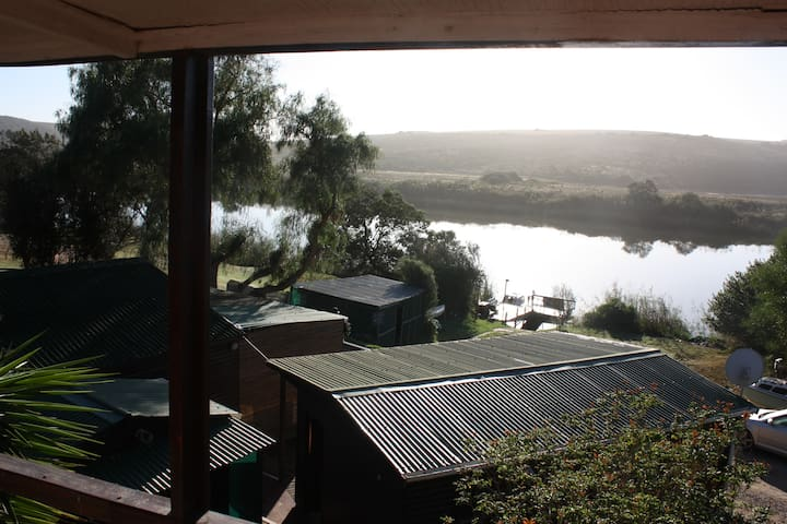 View from the middle cottage across the main entertainment and kitchen cottage up the Breede River