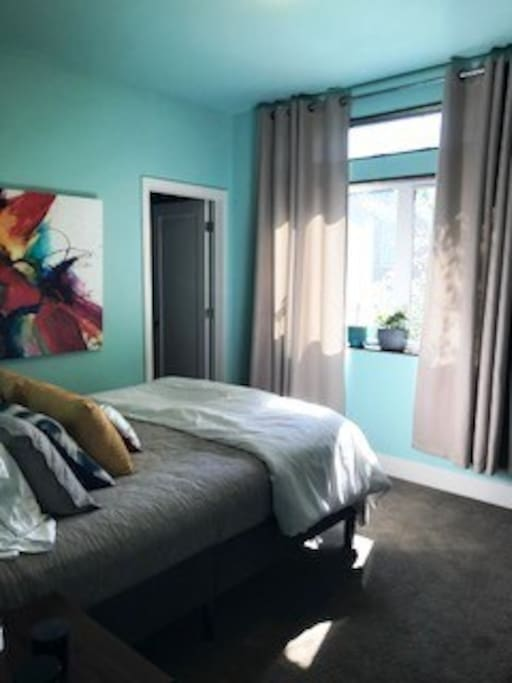 Sunny Bedroom with queen size sleep number bed
