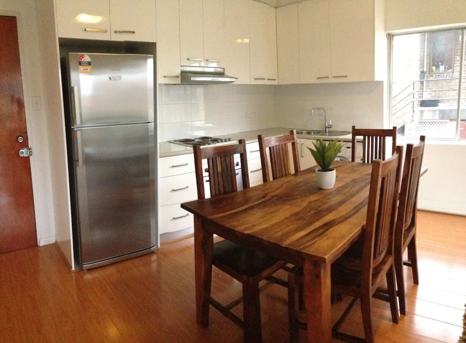 Dining and fully equipped kitchen with facilities