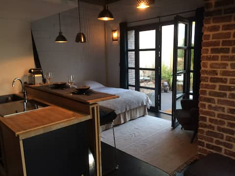 Studio indépendant avec terrasse privée