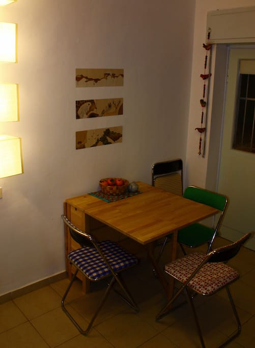 The dining table opens, and suitable for up to 6 people.