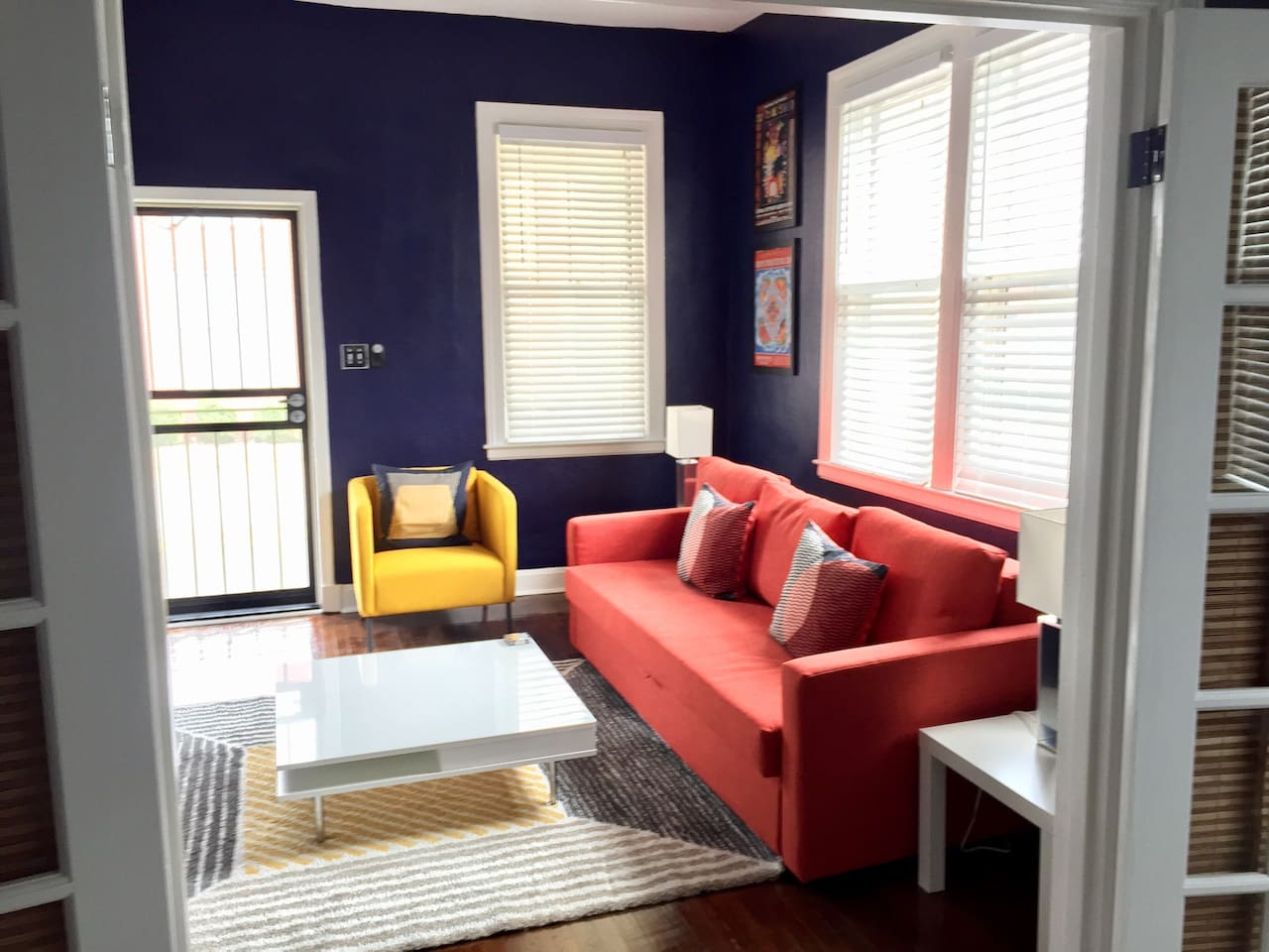"""Living room with 50"""" TV and sofa bed"""