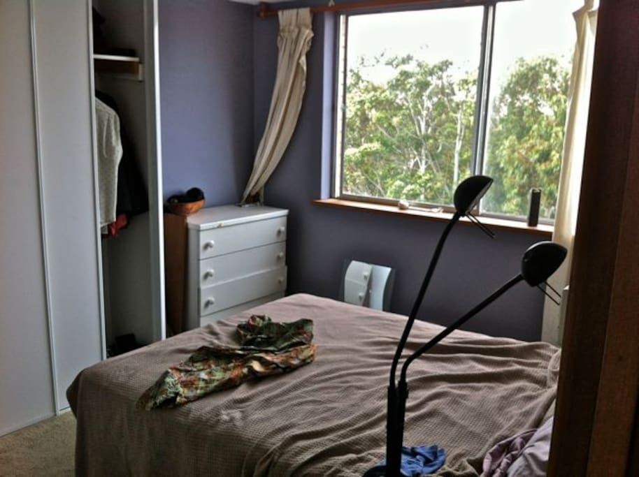 Master bedroom - comfy double bed, lots of storage... lie in bed and see the southern cross.