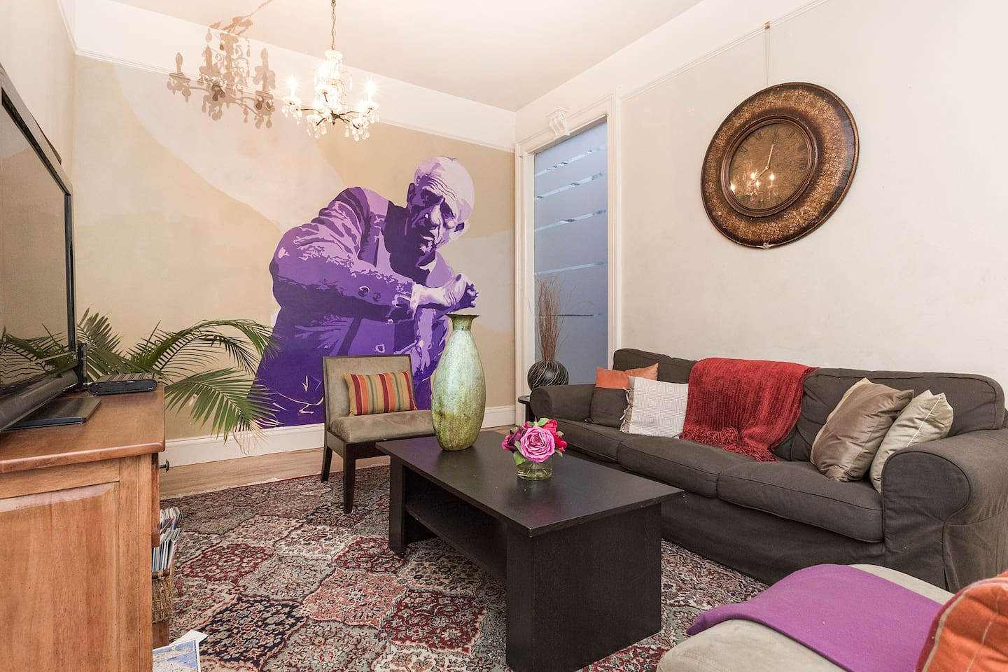 Relax in the living with a wall mural of JD Salinger