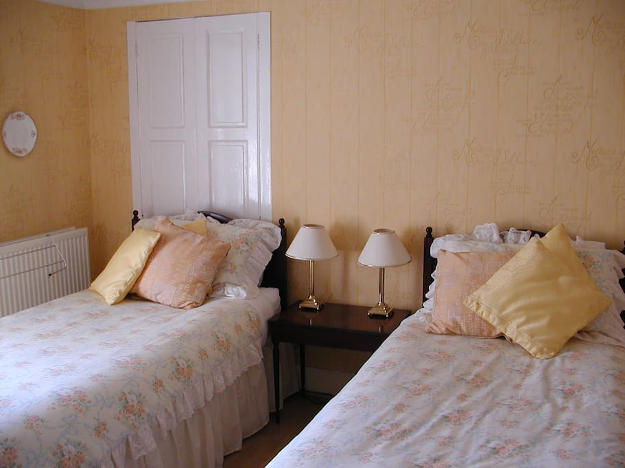 Twin Bedroom middle floor with wonderful sea views from window seat.